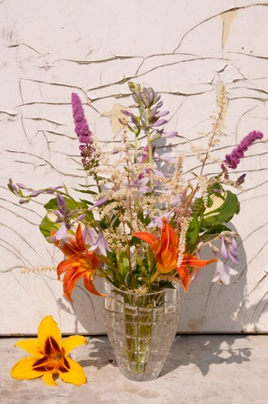 still life bouquet on a crack wall background  still life bouquet on a crack wall background  photo