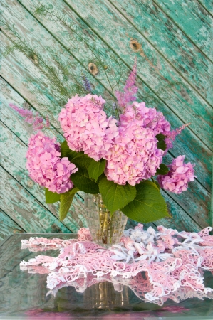 Still life bouquet with pink hydrangea and astilba with homemade crochet tablecloth