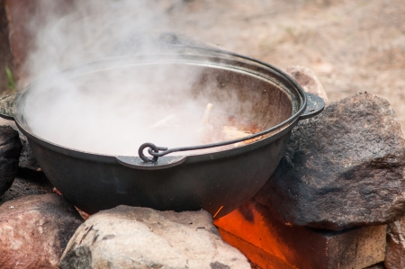 cooking on the iron pot outdoor in fire