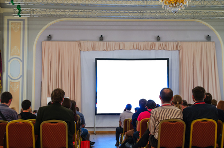buisiness: people sitting at the business conference and white display with space for your text Stock Photo