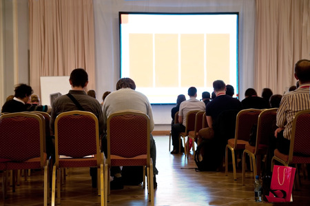 people sitting at the business conference and white display with space for your text photo