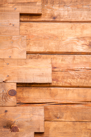 two level legs vertical wooden wall background photo