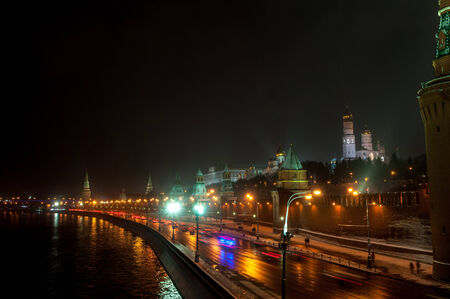 Moscow Kremlin wall and cars at the street at the snowstorm winter night photo