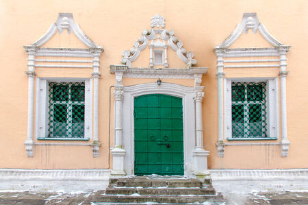 facade of the house with the door and two windows photo