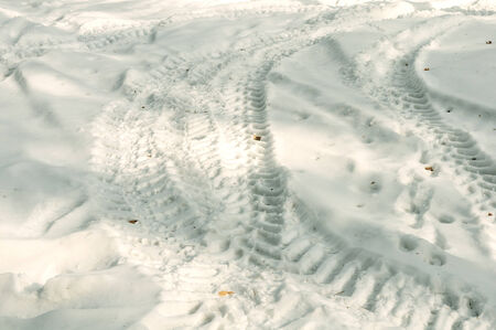 tire tracks imprints on snow photo