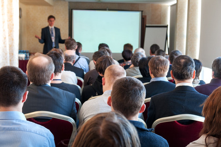 public speaker: people sitting rear at the business conference Stock Photo