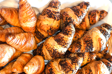 croissants with poppy seeds close up photo