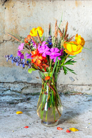 globe-flower, сhaenomeles and other spring flowers still life bouquet photo