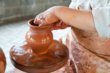 Potter making the pot in traditional style  Close up view photo