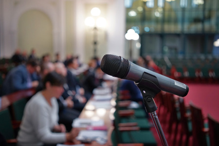 delegates: Microphone in focus against blurred audience