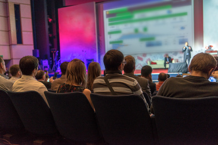 watching: people sitting rear at the business conference Stock Photo