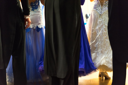 rear view of the ballroom dancers standing on the parket