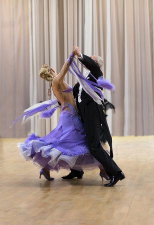 ballroom: senior ballroom dancers dancing valtz rear view