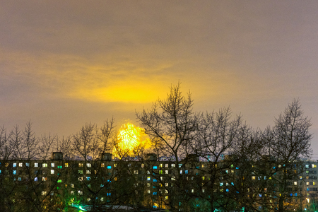 holiday lights display: flashlight fireworks in a Moscow commuter town distinct
