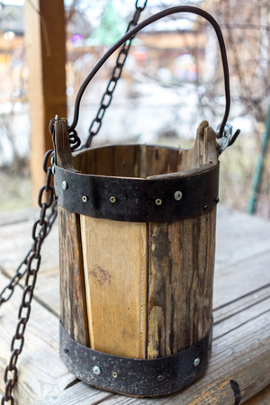 draw well: Detail of old draw well with wooden bucket on a metal chain close up view in Izmailovo Kremlin, Moscow, Russia