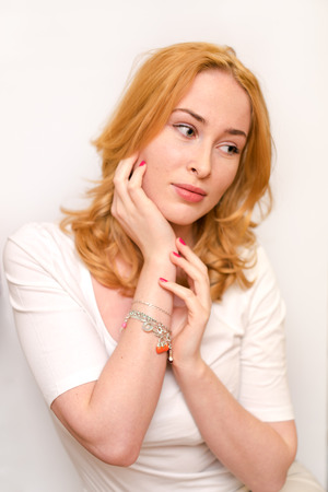 sideways glance: Thoughtful casual caucasian woman looking side - isolated over a white background