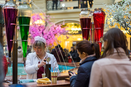 soft drinks: MOSCOW - MARCH 22: People buying of fruit, juices and soft drinks in the GUM store on March 22, 2015 in Moscow. GUM is the large store in Moscow , it is popular among international tourists.