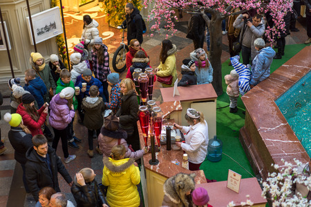 large store: MOSCOW - MARCH 22: People buying of fruit, juices and soft drinks in the GUM store on March 22, 2015 in Moscow. GUM is the large store in Moscow , it is popular among international tourists.