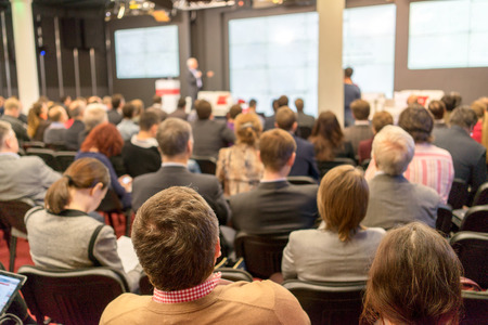 info business: Business Conference and Presentation. Audience at the conference hall. Stock Photo