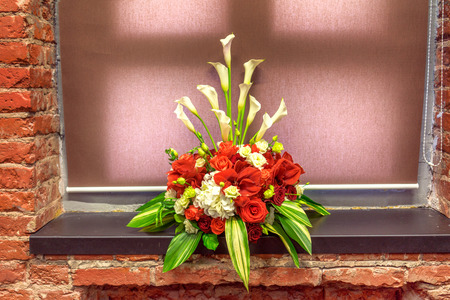 window sill: bouquet of red amarillis on a window sill