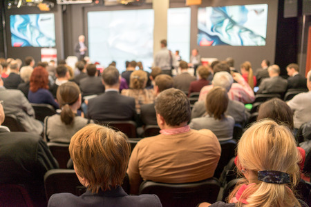 Speaker at Business Conference and Presentation. Audience in the conference hall. Business and Entrepreneurship. Stock Photo
