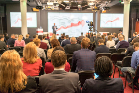 Speaker at Business Conference and Presentation. Audience in the conference hall. Business and Entrepreneurship. Standard-Bild