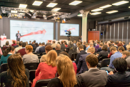 workshop seminar: Speaker at Business Conference and Presentation. Audience in the conference hall. Business and Entrepreneurship. Stock Photo