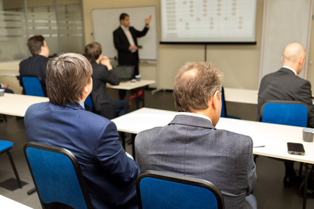 conference halls: Business workshop and presentation. Audience at the conference room. Stock Photo