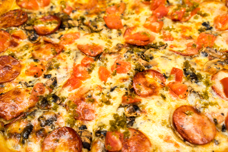 Appetizing background pepperoni pizza closeup filling the frame. Stock Photo