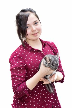 teenager caucasian girl holding chinchilla on her arms isolated on white background photo