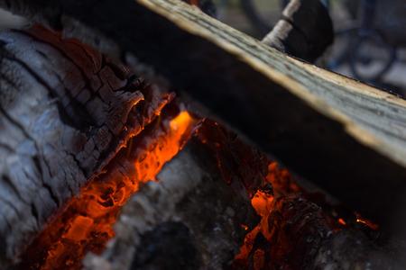 smolder: Burning smolder firewood in the fireplace close up Stock Photo