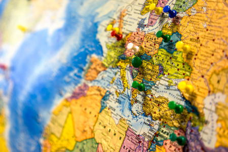 europe closeup: Lot of push pins pointing at European countries, Russian map. Stock Photo