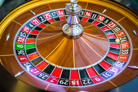 roulette wheel: Roulette wheel in casino Stock Photo