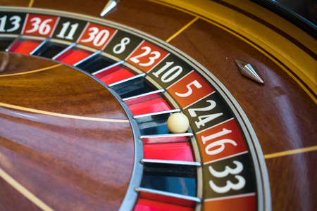 Roulette wheel in casino Stock Photo