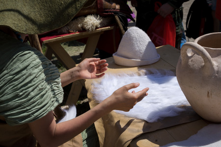 milling woolen hats photo