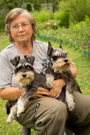 pensioneer woman with two dogs