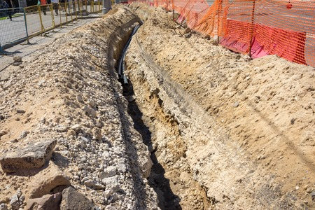 the trench dug in the earth Standard-Bild