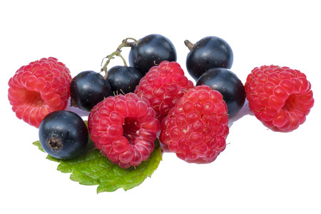 black currants: Small group of rasberries and black currants with fresh green leaf on white background Stock Photo