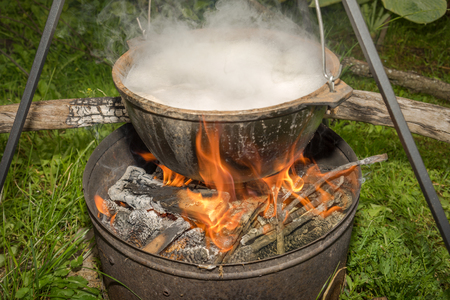 boiling pot: Cooking in field conditions, boiling pot at the campfire on picnic.