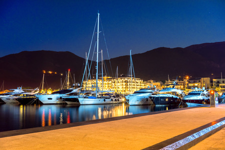 Sailing boats and yachts in marina at night. Tivat. Montenegro Stockfoto