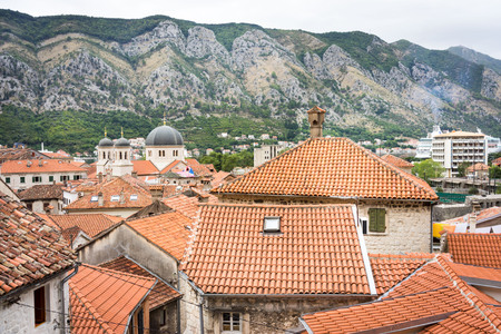 middle ages boat: roofs of the old town Kotor, Montenegro
