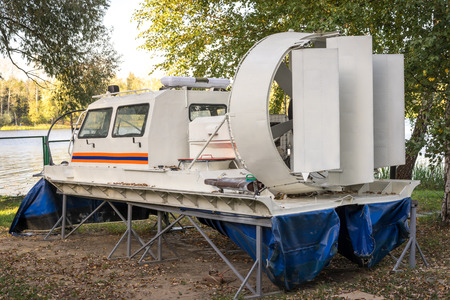 hovercraft: Hovercraft on the bank of the lake, rear view Stock Photo