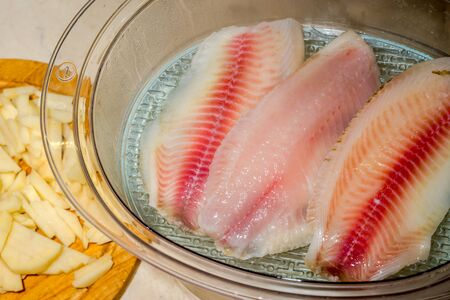 filets: cooking red filets of tilapia on steam Stock Photo