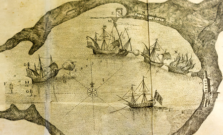 Antique sea map of a vessel battle in a port close up detail