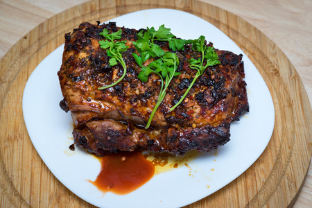 baked meat: Homemade baked meat with parsley on a wooden board