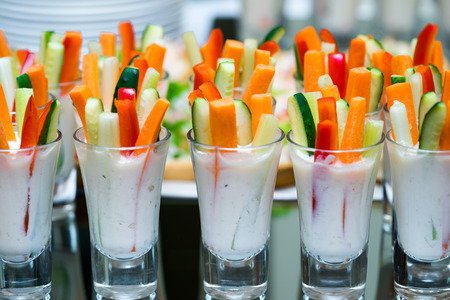 lunch tray: glasses with vegetables snacks on banquet table Stock Photo