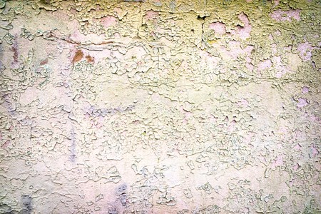crannied: old tacky rough stone wall background Stock Photo