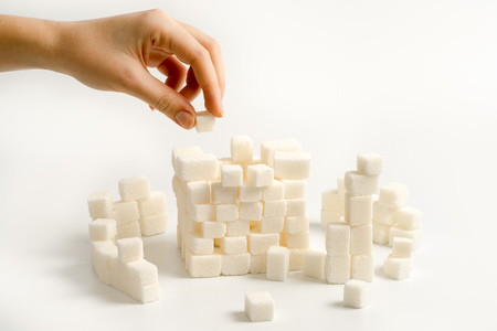sugar cubes: building a citadel from white sugar cubes Stock Photo