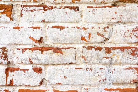 brick facades: old painted brick wall texture Stock Photo