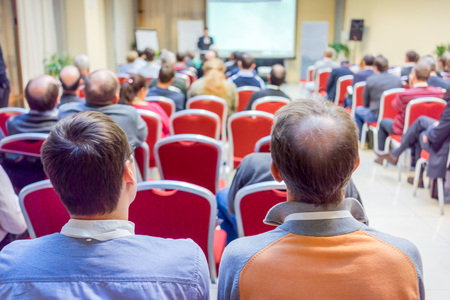 obscured face: people at the business conference